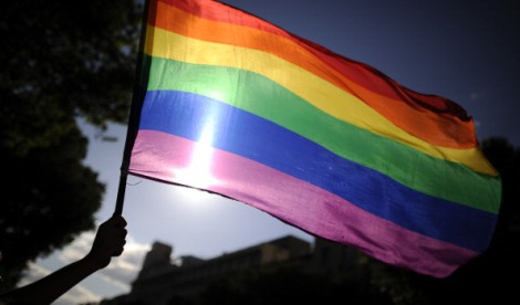 A participants holds a rainbow flag during the gay and lesbian pride parade in the center of Madrid on June 30, 2012. AFP PHOTO/Pedro ARMESTRE        (Photo credit should read PEDRO ARMESTRE/AFP/GettyImages)